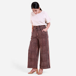 Front View of a Model wearing Striped High-Rise Baggy Pants