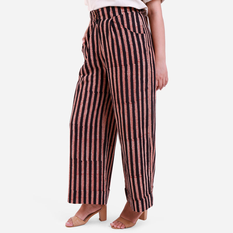 Left View of a Model wearing Striped High-Rise Baggy Cotton Pant