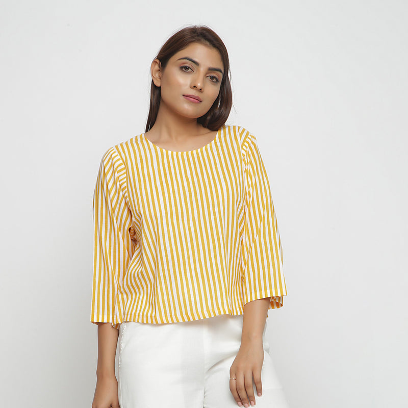 Front View of a Model wearing Yellow Hand Screen Printed Straight Top