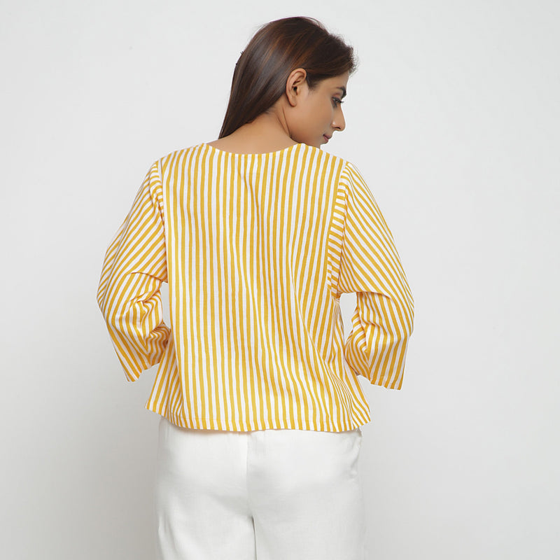Back View of a Model wearing Yellow Hand Screen Printed Straight Top