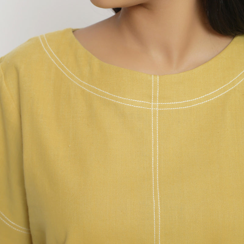 Front Detail of a Model wearing  Vegetable Dyed Handspun Paneled Top