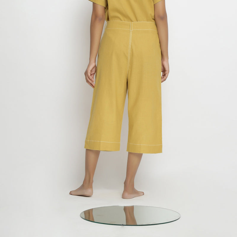Back View of a Model wearing Yellow Mid Rise Vegetable Dyed Culottes