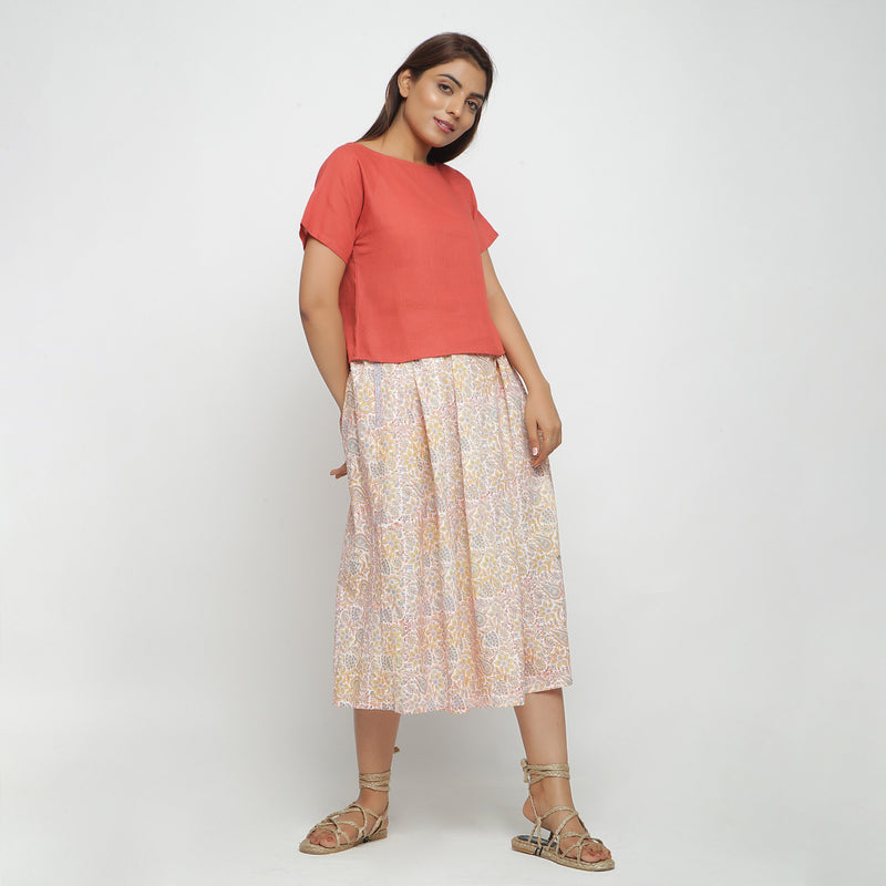 Front View of a Model wearing Brick Red Top and Subtle Paisley Skirt Set