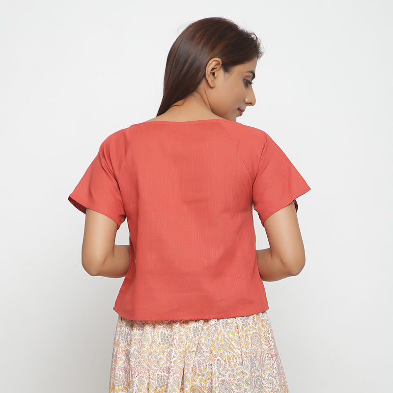 Back View of a Model wearing Brick Red Boat Neck Half Sleeve Cotton Top