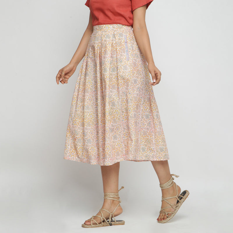 Left View of a Model wearing Sanganeri Pleated Block Printed Skirt