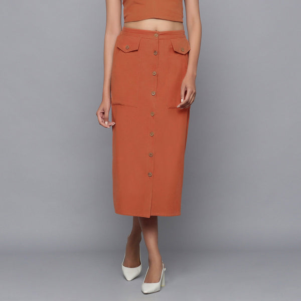 Front View of a Model wearing Sunset Rust Button-Down Midi Skirt