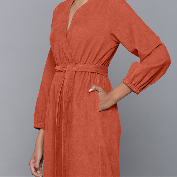 Left Detail of a Model wearing Sunset Rust Corduroy Comfy Jumpsuit