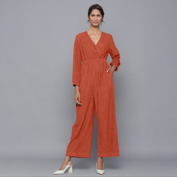 Front View of a Model wearing Sunset Rust Corduroy Comfy Jumpsuit