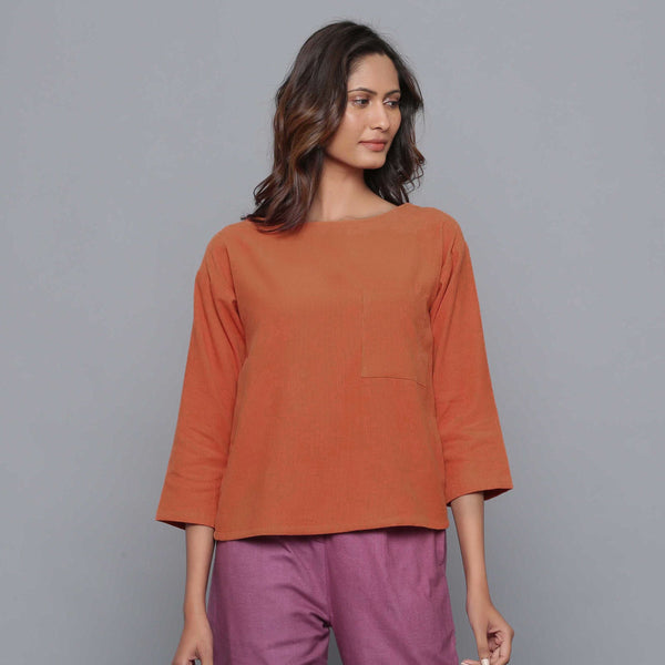 Front View of a Model wearing Sunset Rust Corduroy Drop Shoulder Top