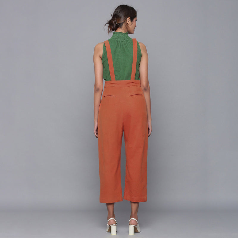 Back View of a Model wearing Sunset Rust Cotton Corduroy Dungaree