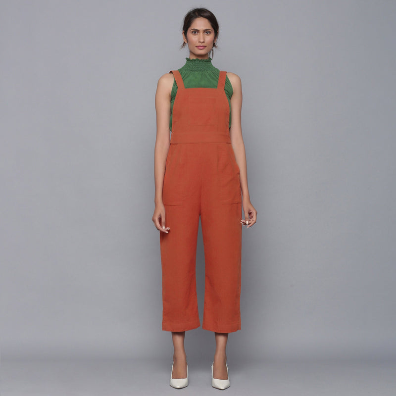 Front View of a Model wearing Sunset Rust Cotton Corduroy Dungaree