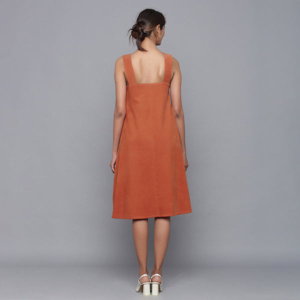 Back View of a Model wearing Sunset Rust Corduroy Flared Dress