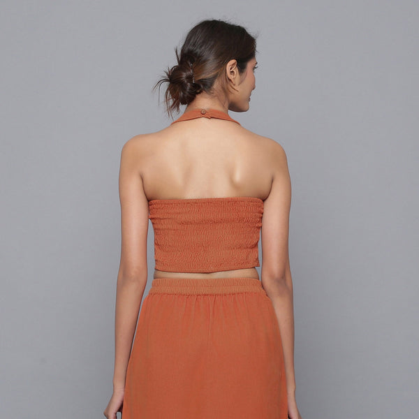 Back View of a Model wearing Sunset Rust Corduroy Halter Neck Top