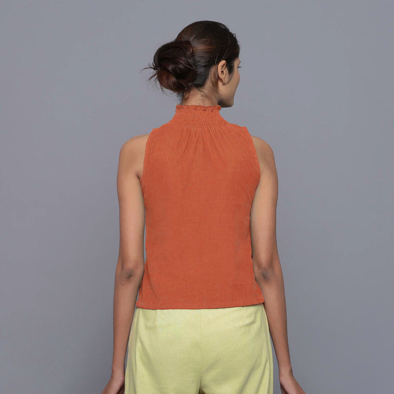 Back View of a Model wearing Sunset Rust Cotton Corduroy High Neck Top