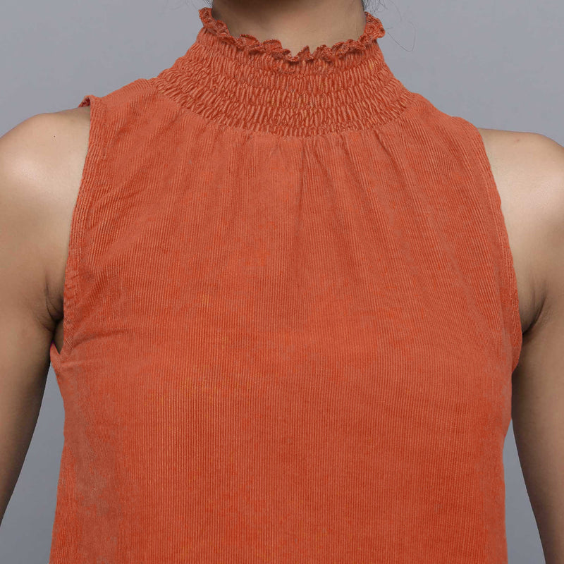 Front Detail of a Model wearing Sunset Rust Cotton Corduroy High Neck Top