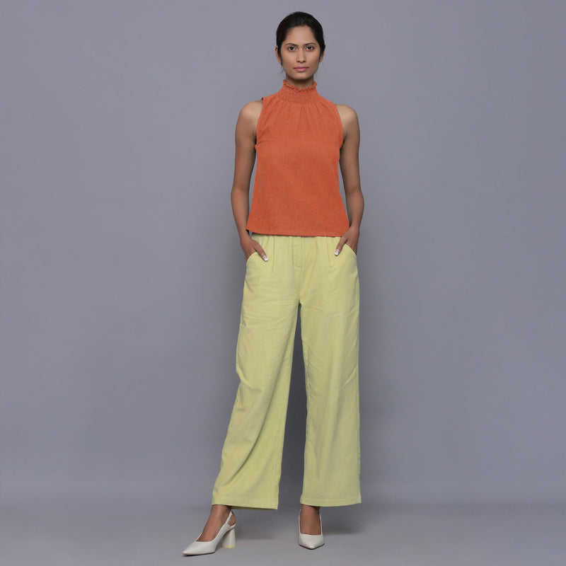 Front View of a Model wearing Sunset Rust Cotton Corduroy High Neck Top