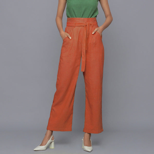 Front View of a Model wearing Sunset Rust Cotton Corduroy Pant