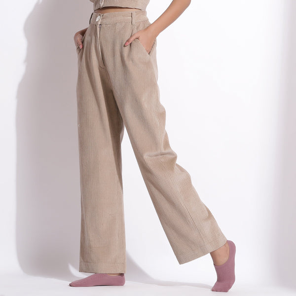 Left View of a Model wearing Beige Corduroy Wide-Legged Trouser Pant