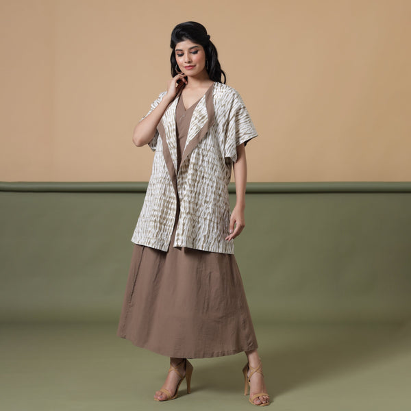 Front View of a Model wearing Taupe Shibori Front Open Overlay