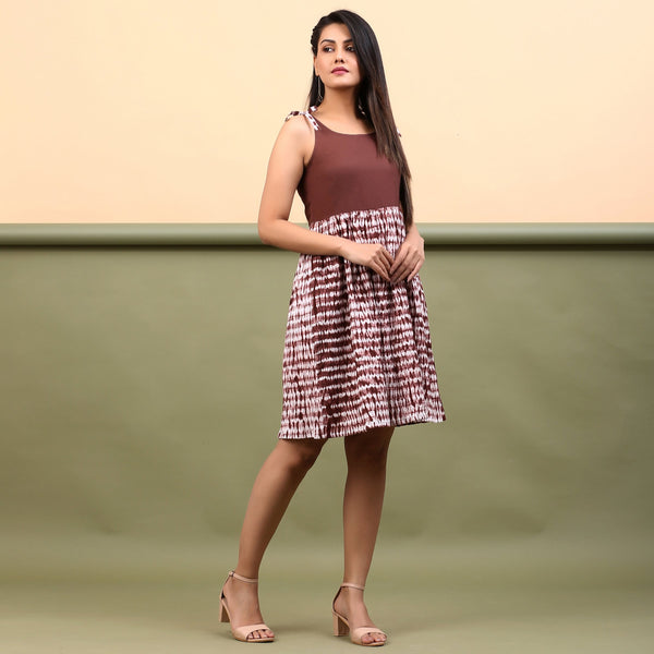 Right View of a Model wearing Taupe Shibori Gathered Short Dress