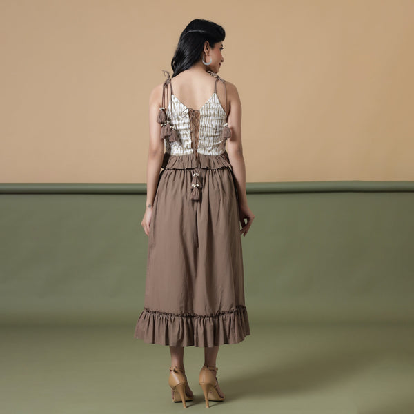 Back View of a Model wearing Taupe Shibori Ruffled Top and Skirt Set
