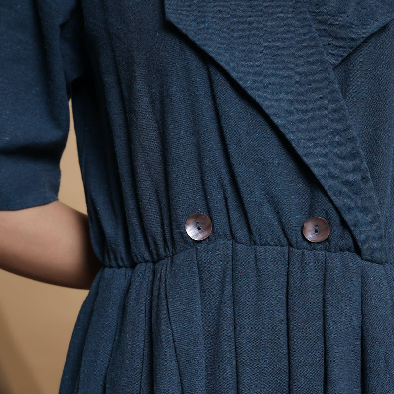 Front Detail of a Model wearing Teal Blue Lapel Collar Pleated Jumpsuit