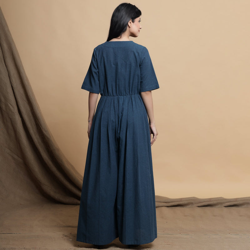 Back View of a Model wearing Teal Blue Lapel Collar Pleated Jumpsuit
