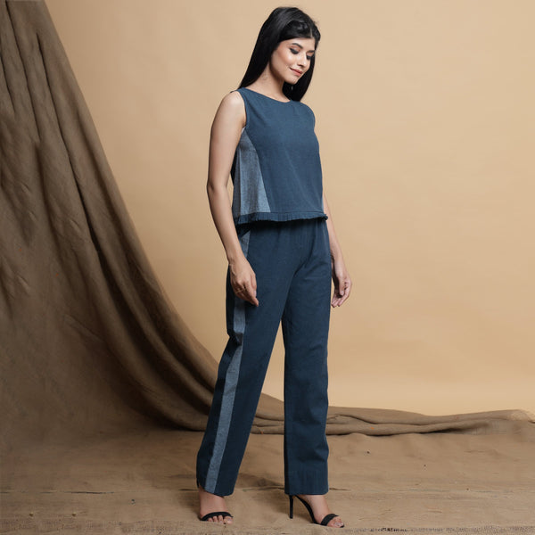 Right View of a Model wearing Teal Blue Side-Panelled Paperbag Pant