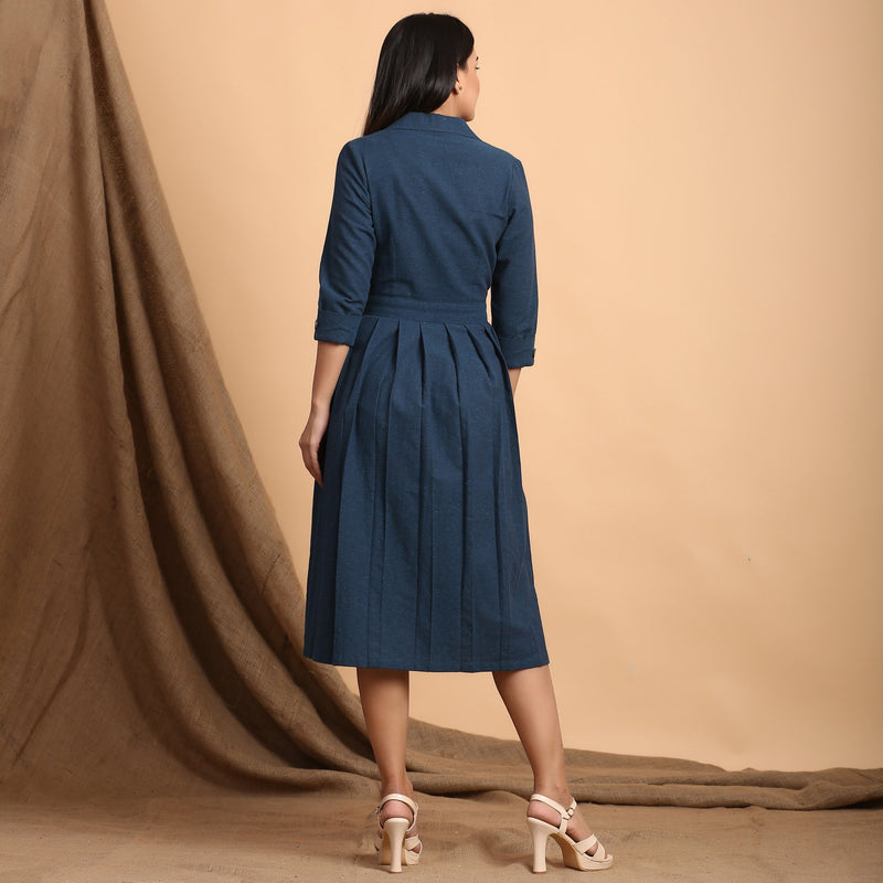 Back View of a Model wearing Teal Pleated Knee Length Wrap Dress