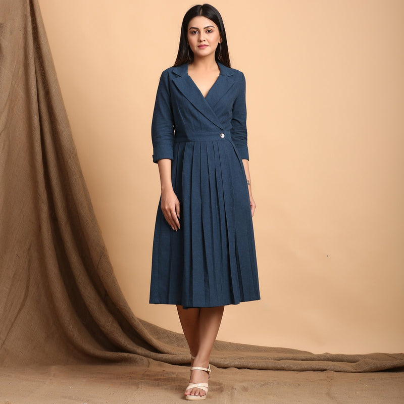 Front View of a Model wearing Teal Pleated Knee Length Wrap Dress