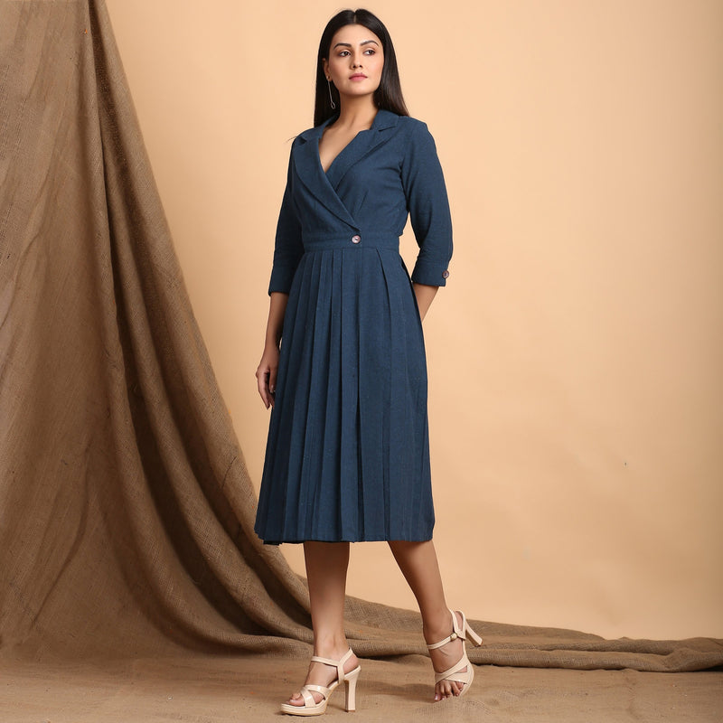 Left View of a Model wearing Teal Pleated Knee Length Wrap Dress