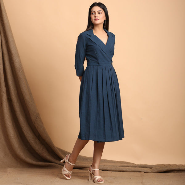 Right View of a Model wearing Teal Pleated Knee Length Wrap Dress