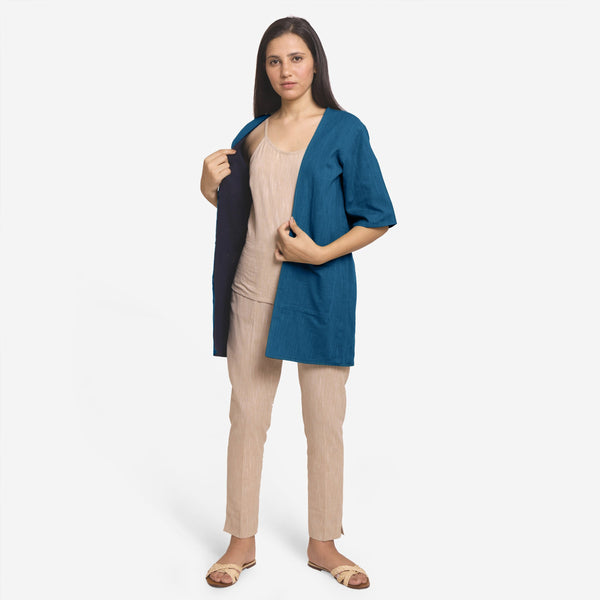 Front View of a Model wearing Teal Reversible Cotton Flax Front Open Overlay