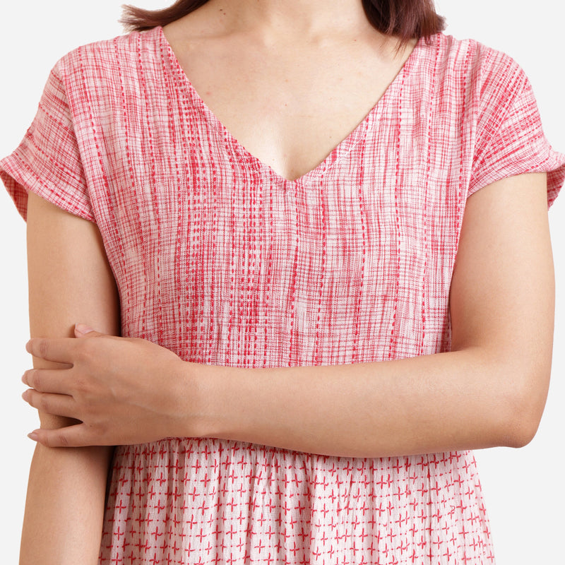 Front Detail of a Model wearing Crinkled Cotton V-Neck Tiered Midi Sundress