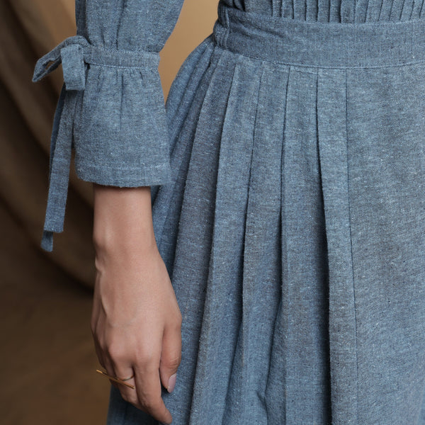 Front Detail of a Model wearing Turkish Blue Pleated Midi Skirt