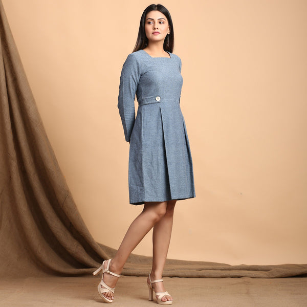 Right View of a Model wearing Turkish Blue Pleated Short Dress