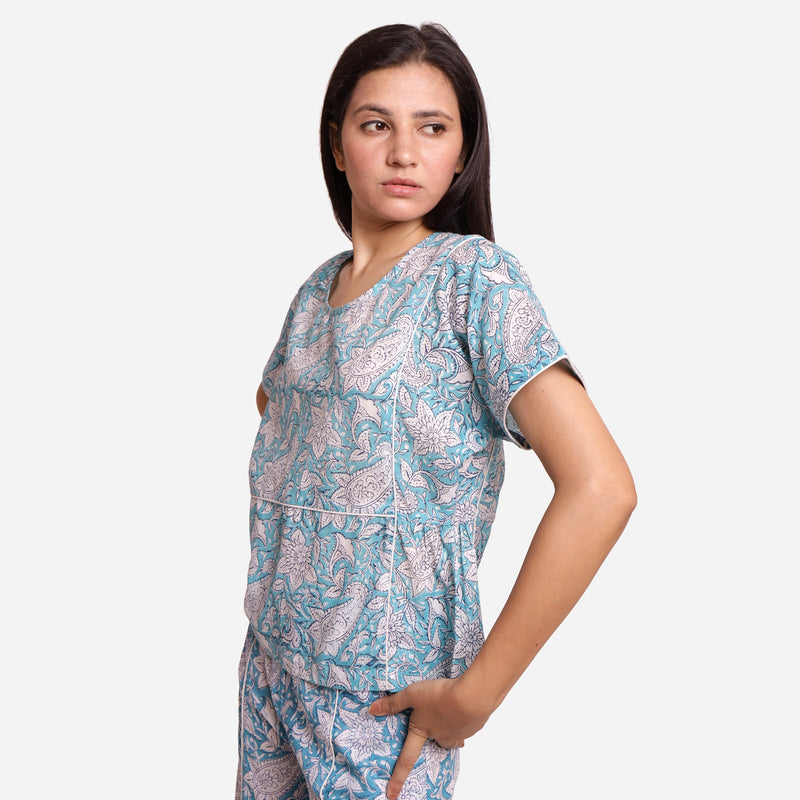 Left View of a Model wearing Turquoise Sanganeri Paisely Print Top