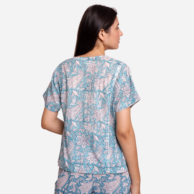 Back View of a Model wearing Turquoise Sanganeri Paisely Print Top
