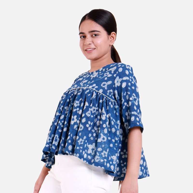 Left View of a Model wearing Natural Dyed Dabu Printed Gathered Top