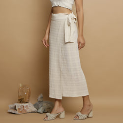 Left View of a Model wearing Undyed Banded Cotton Flax Wrap Skirt