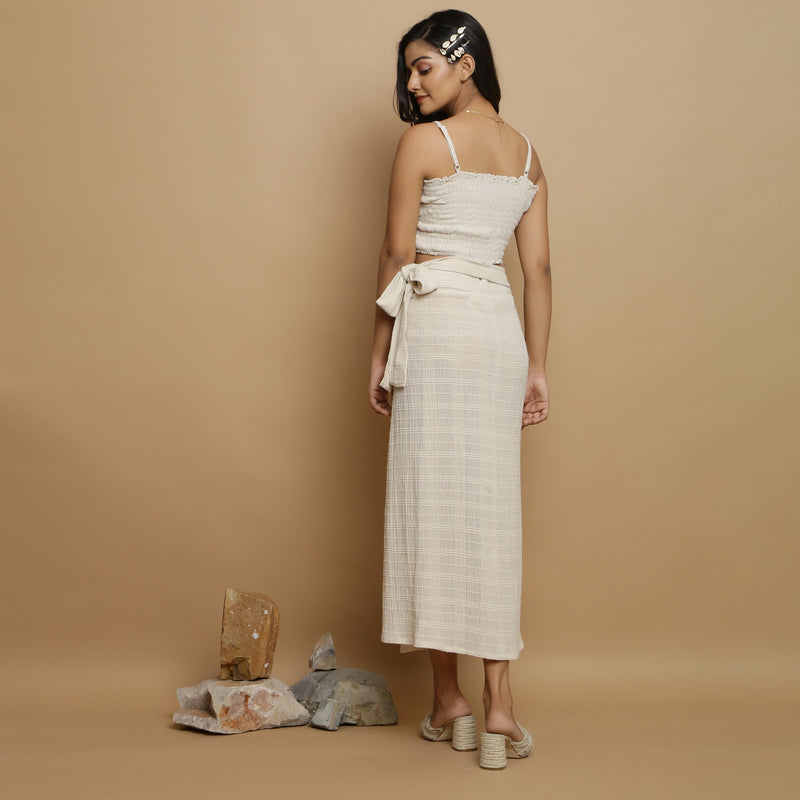 Back View of a Model wearing Undyed Banded Cotton Flax Wrap Skirt