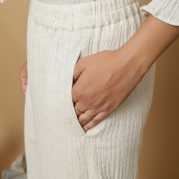 Left Detail of a Model wearing Undyed Elasticated Mid Rise Ecru Pant
