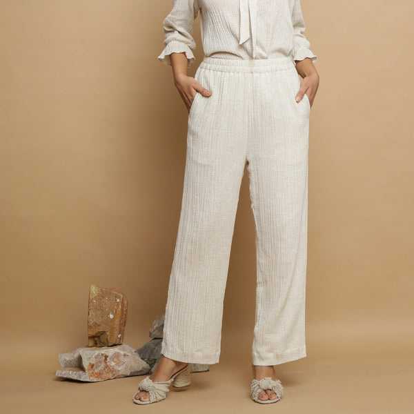 Front View of a Model wearing Undyed Elasticated Mid Rise Ecru Pant
