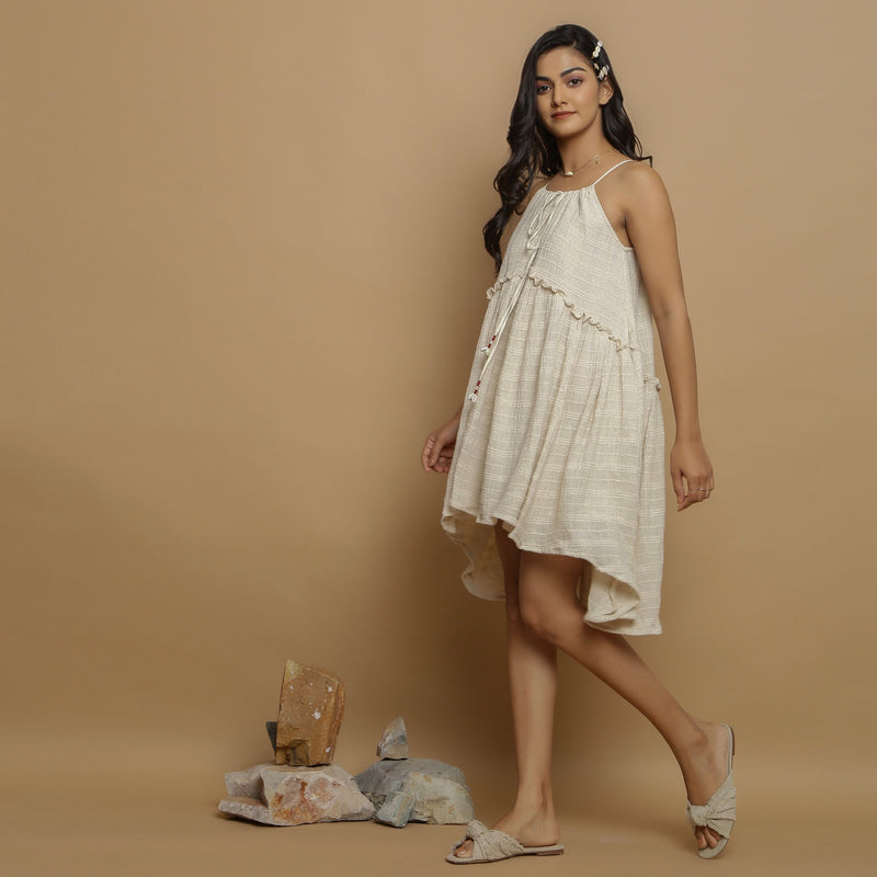 Left View of a Model wearing Undyed Cotton Flax Flared Dress