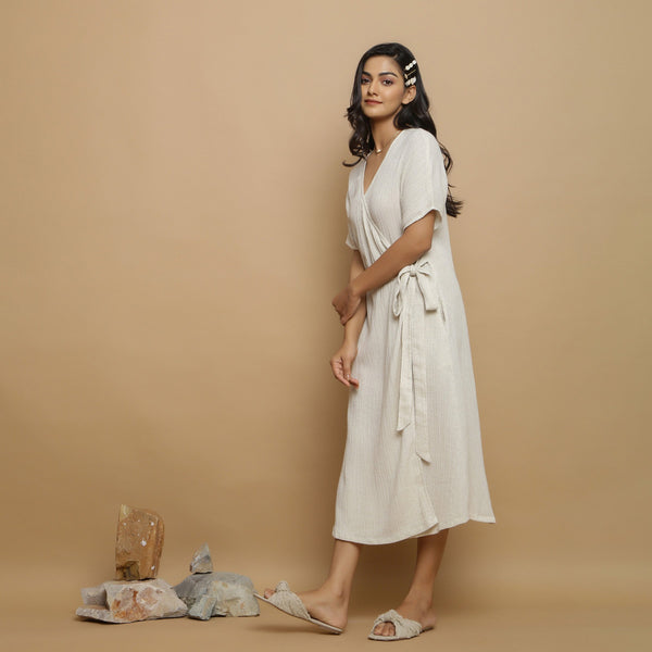 Left View of a Model wearing Flared Undyed Cotton Flax Maxi Dress
