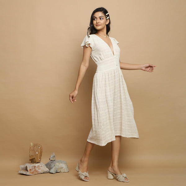Right View of a Model wearing Cotton Flax Undyed Gathered Dress