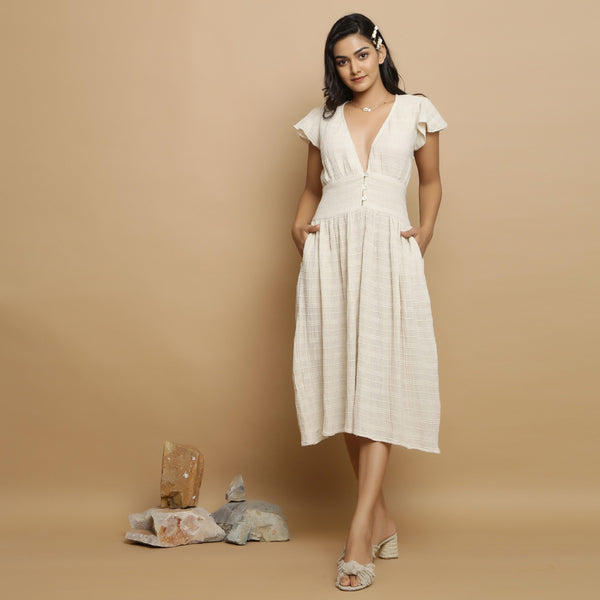 Front View of a Model wearing Cotton Flax Undyed Gathered Dress