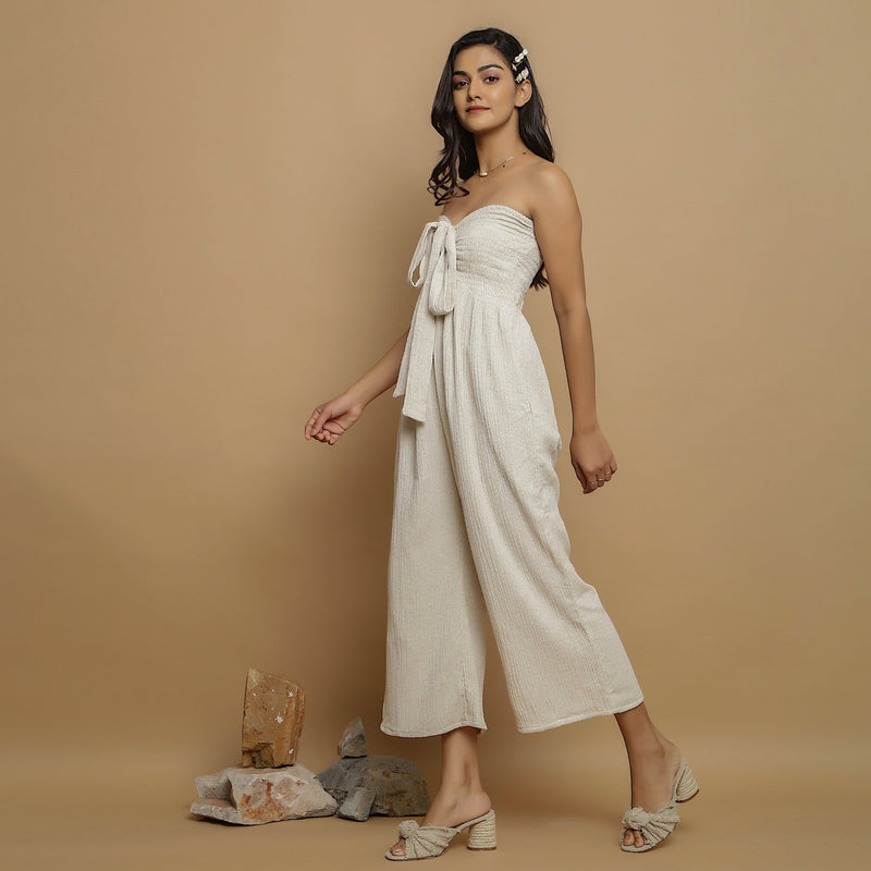 Left View of a Model wearing Undyed Cotton Flax Straight Jumpsuit