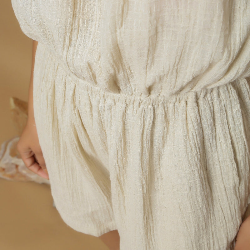 Front Detail of a Model wearing Undyed Crinkled Cotton Flax Tube Playsuit