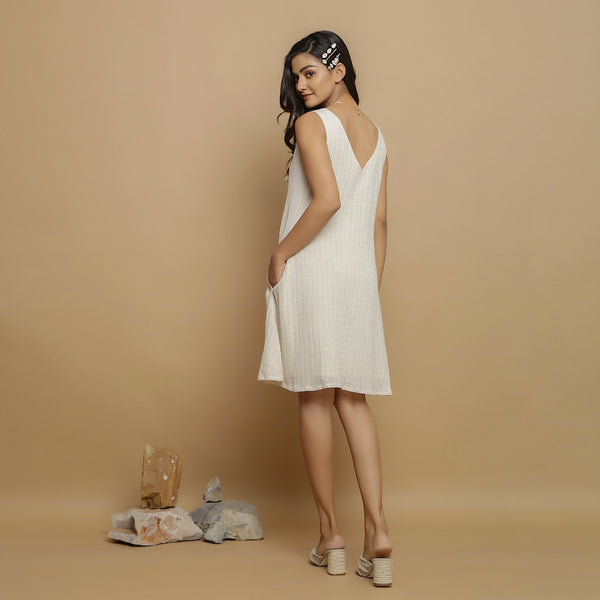 Back View of a Model wearing Undyed Cotton Deep Neck A-Line Dress